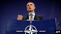 NATO Secretary-General Jens Stoltenberg gestures during a press conference at the military alliance's headquarters in Brussels on December 1.