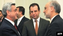 Armenian President Serzh Sarkisian (left) meets with Iranian Foreign Minister Ali Akbar Salehi (right) in Yerevan.