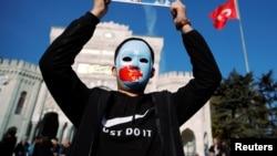 چین کې اویغور اعتراض کوونکی