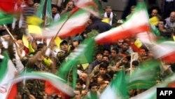 Basij militia wave Iranian flags