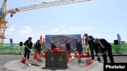 Armenia - Senior Armenian and Chinese officials break ground on the site of a new Chinese embassy bulilding in Yerevan, 9Aug2017.
