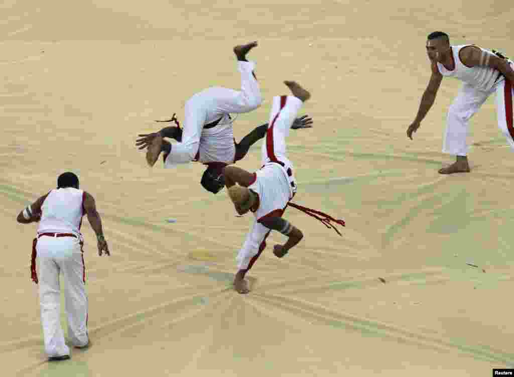 Dancers demonstrate the Brazilian martial art Capoeira during the opening ceremony.