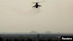 Донецк әуежайына әуеден соққы беріп жүрген әскери Ми-24 тікұшағы. Донецк, 27 мамыр 2014 жыл.