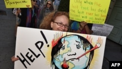 АҚШ-тағы әлем климатының жылынуына қарсы шаралар қабылдауды талап еткен демонстрация. Қараша 2015 жыл (Көрнекі сурет).