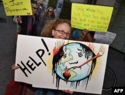 Акция экологических активистов в США накануне климатической конференции в Париже