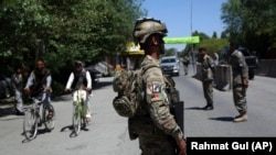 Afghan security forces stand guard during the first day of Eid al-Fitr in Kabul on May 24.