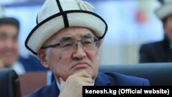 Асан Жакшылыков.