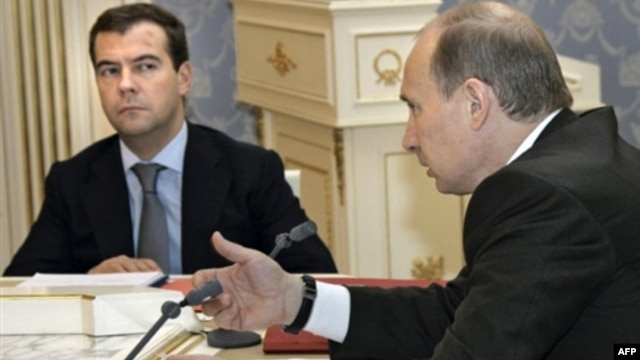 Russian officers claim that Vladimir Putin (right) had to push then-President Dmitry Medvedev to take action after the Georgian Army advanced into South Ossetia in 2008.