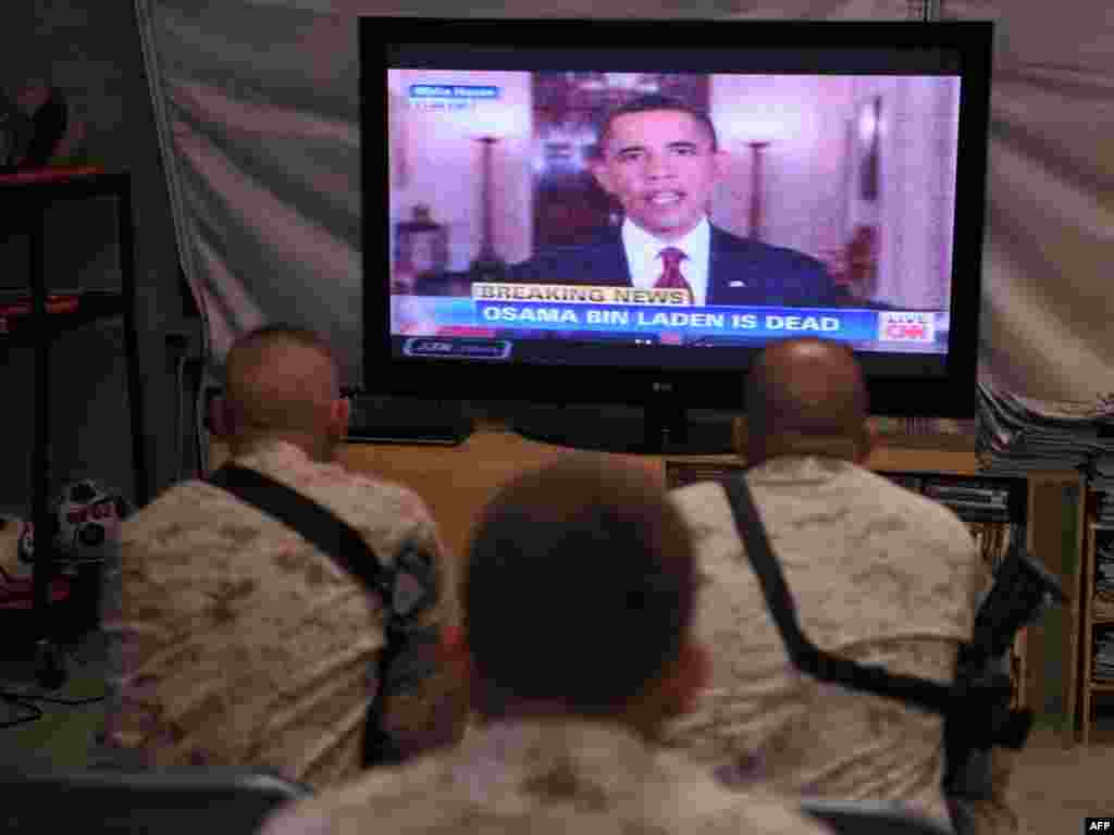 U.S. Marines in Helmand Province in Afghanistan watch as President Barack Obama announces the death of Osama bin Laden.
