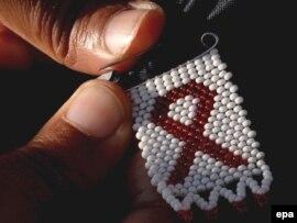 СПИД дертіне қарсы күрес белгісі. Көрнекі сурет.