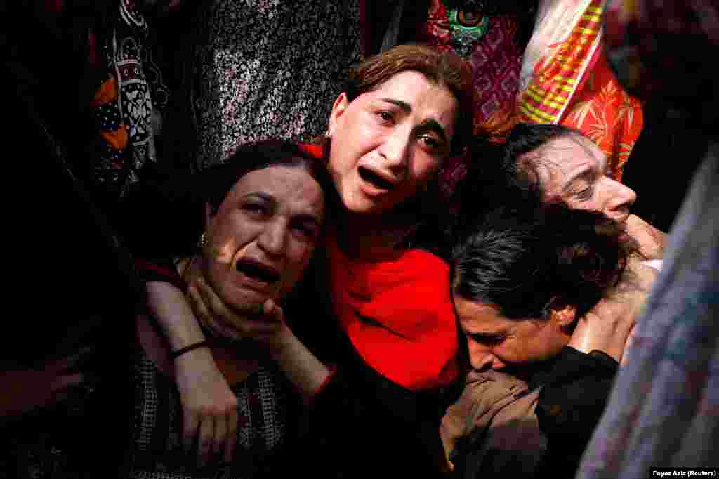 "A transgender group mourns the death of a companion during a protest demanding justice for the deceased on August 20 in Peshawar, Pakistan. Nasir, also known as ""Naso,"" was shot dead during a wedding ceremony and her body mutilated and dismembered. (Reuters/Fayaz Aziz)"