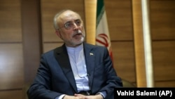 IRAN -- Iranian nuclear chief Ali Akbar Salehi speaks in an interview with The Associated Press at the headquarters of Iran's atomic energy agency, in Tehran, September 11, 2018