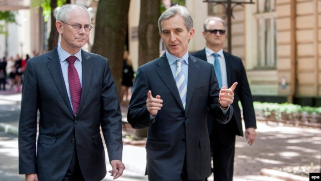 European Council President Herman Van Rompuy (left) talks with Moldovan Prime Minister Iurie Leanca in Chisinau on May 13.