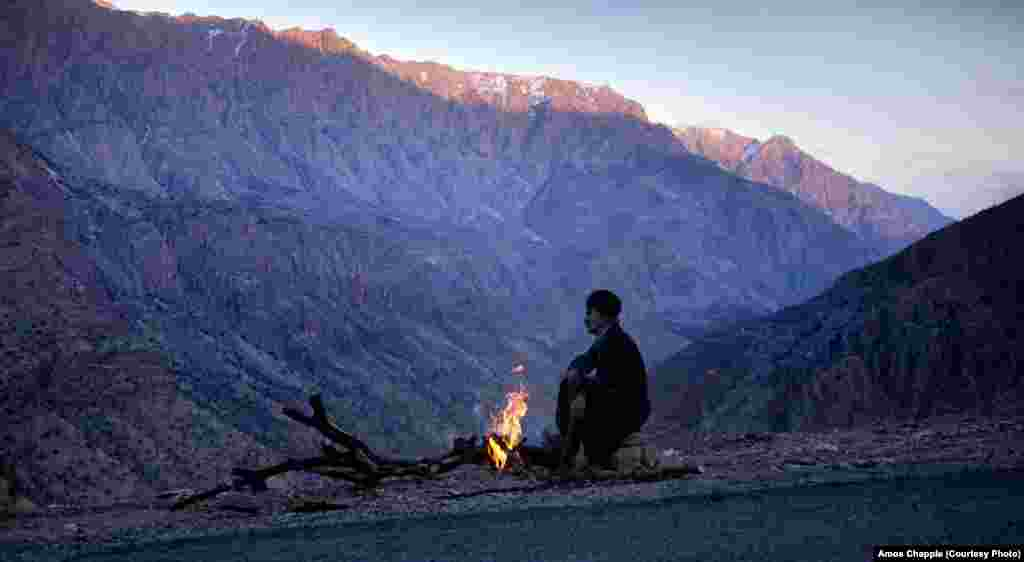 A Kurdish man settles in for a night of guarding roadwork machinery in the mountains near the Iraqi border. The border is rife with smugglers who carry alcohol from Iraq (where alcohol is legal) into the villages on the Iranian side. In Tehran, a can of beer on the black market fetches around $10.