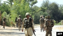 Pakistani troops patrol in the troubled Bajaur agency (file photo)