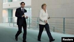 Президент Туркменистана Гурбангулы Бердымухамедов и канцлер Германии Ангела Меркель.