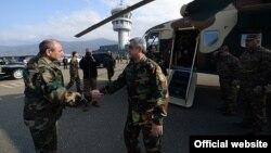 The breakaway Nagorno-Karabakh region's leader Bako Sahakyan (left) greets Armenian President Serzh Sarkisian at Stepanakert airport on November 13.