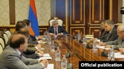 Armenian President Serzh Sarkisian met senior officials in Yerevan on June 27 before announcing his latest proposal to defuse protests sparked by planned utility rate hikes.