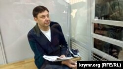 RIA Novosti-Ukraine chief Kirill Vyshinsky appears in court in Kherson on June 1.