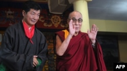 Lobsang Sangay (left) poses with the Dalai Lama after taking the oath of office as the new prime minister of the Tibetan government-in-exile last year.