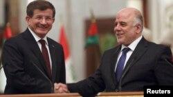 رئيس الوزراء حيدر العبادي ونظيره التركي أحمد داودأوغلو