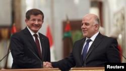 تشرين الثاني 2014 رئيس الوزراء العراقي حيدر العبادي يستقبل في بغداد نظيره التركي احمد داوود اوغلو