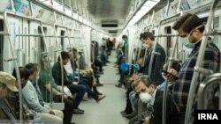 Commuters wearing masks against coronavirus on Tehran underground (Metro) on April 7, 2020.