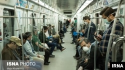 Commuters wearing masks against coronavirus on Tehran underground (metro) on April 7, 2020.