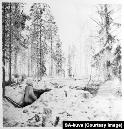 A Finnish fighter scans the forest.