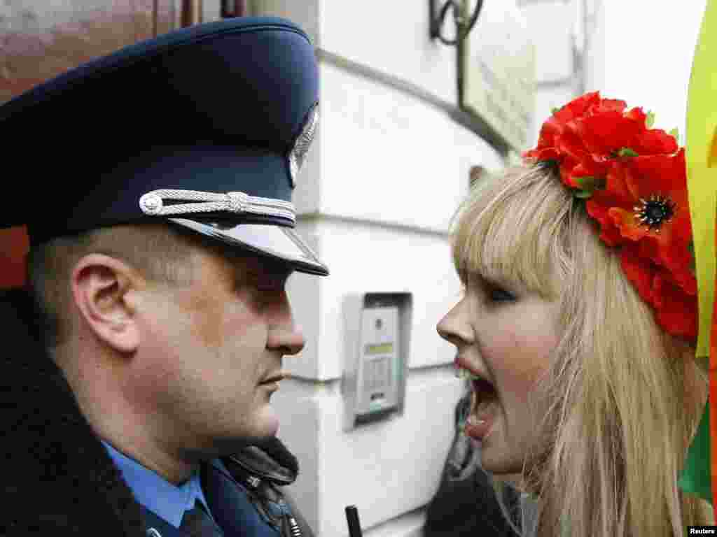 An activist from the women's rights organization Femen shouts at an Interior Ministry officer as she takes part in a rally to support Sakineh Mohammadi Ashtiani, at the Iranian Embassy in Kyiv on November 3. Ashtiani, whose sentence of execution by stoning for adultery provoked a worldwide outcry, will instead be hanged for the murder of her husband.Photo by Konstantin Chernichkin for Reuters