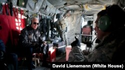 Vice President Joe Biden talks with General David Petraeus, commander of the International Security Assistance Force and U.S. Forces in Afghanistan, aboard a Chinook helicopter over Kabul in 2011.
