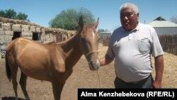Житель аульного округа Жанарык Кызылординской области Болат Сейтбеков. 25 июня 2014 года.