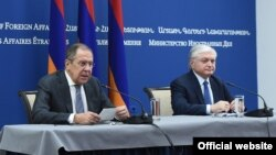 Russian Foreign Minister Sergei Lavrov (left) and Armenian Foreign Minister Edward Nalbandian hold a joint press conference in Yerevan on November 21.