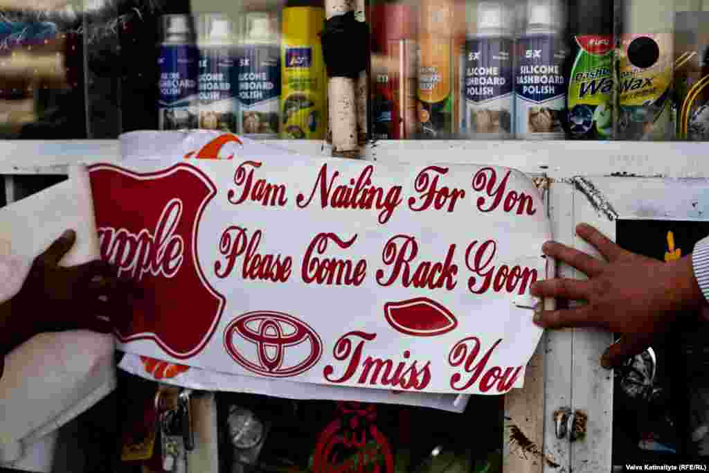 """I am nailing for you. Please come back soon. I miss you."" One shopkeeper says he sells around 20 stickers per day."