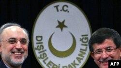Iranian Foreign Minister Ali Akbar Salehi (left) Turkish Foreign Minister Ahmet Davutoglu in Ankara.