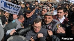 Armenian riot police clash with activists protesting against pension reform in Yerevan last month.