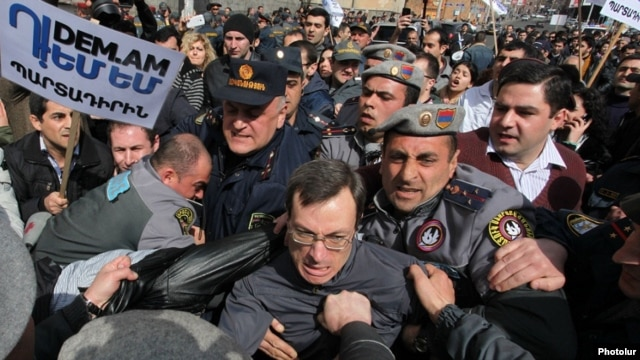Armenia - Riot police clash with activists protesting against pension reform in Yerevan, 7Mar2014.