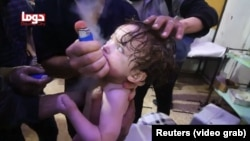 A child cries as it receives treatment following an alleged chemical weapons attack in the Syrian town of Douma on April 7.