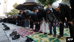 Muslims offer Eid al-Adha prayers at the central Gazi-Husref Bey Mosque in Sarajevo in October 2012.