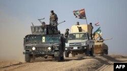 Իրաքի զինված ուժերը և աշխարհազորայինները շարժվում են դեպի Մոսուլին մերձակա բնակավայրերից մեկը, հոկտեմբեր, 2016թ․