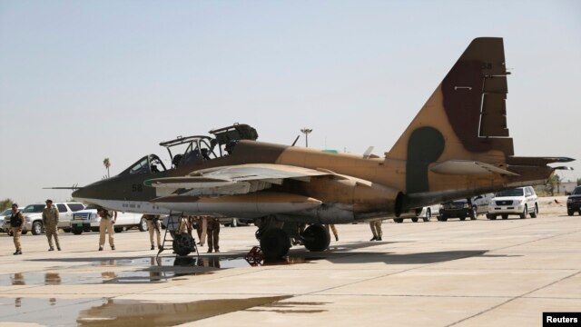 A Russian Sukhoi Su-25 fighter plane arrives at Iraq's Al-Muthanna military airbase at Baghdad airport earlier this month.