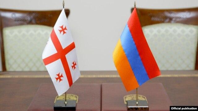 Armenia - Armenian (R) and Georgian flags on a negotiating table in Yerevan, 29Jan2014.