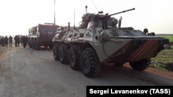 Russian Army vehicles are seen on a joint patrol of the M4 motorway with Turkish troops in the Idlib deescalation zone in northeast Syria. (file photo)