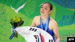 Олимпийская чемпионка в женском одиночном фигурном катании Ю-На Ким из Южной Кореи