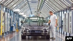 A Volkswagen employee polishes a VW Phaeton car at the company's so-called transparent factory in Dresden.