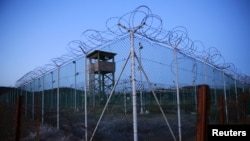 Chain link fence and concertina wire surrounds a deserted guard tower within Joint Task Force Guantanamo's Camp Delta at the U.S. Naval Base in Guantanamo Bay, March 2016.