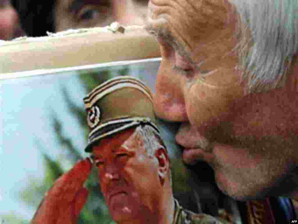 A supporter of the ultra-nationalist Serbian Radical Party kisses a picture of Mladic in Belgrade on May 6, 2008.