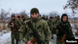 "Pro-Russian separatists from the Chechen ""Death"" battalion walk during a training exercise in the territory controlled by the self-proclaimed Donetsk People's Republic on December 8."