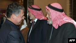 Jordan's King Abdullah II (left) shakes hands with Hamzi Mansour, leader of the Islamic Action Front, during a meeting in Amman on February 3.