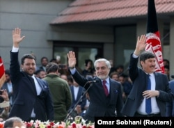 Abdullah Abdullah (center) gestures to his supporters after his own swearing-in ceremony in Kabul on March 9.